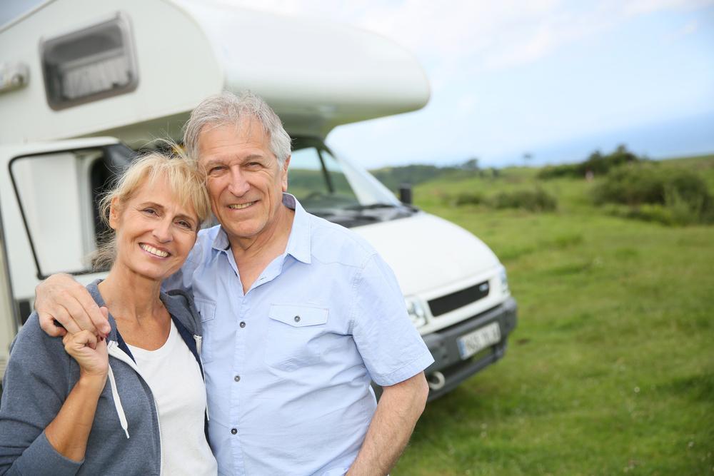 senior-couple-in-front-camper-rv